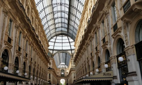 Private Italian courses in Milan - student walking in a street passage