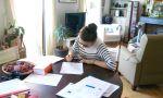 Private Spanish courses in Madrid - student revising her Spanish lessons